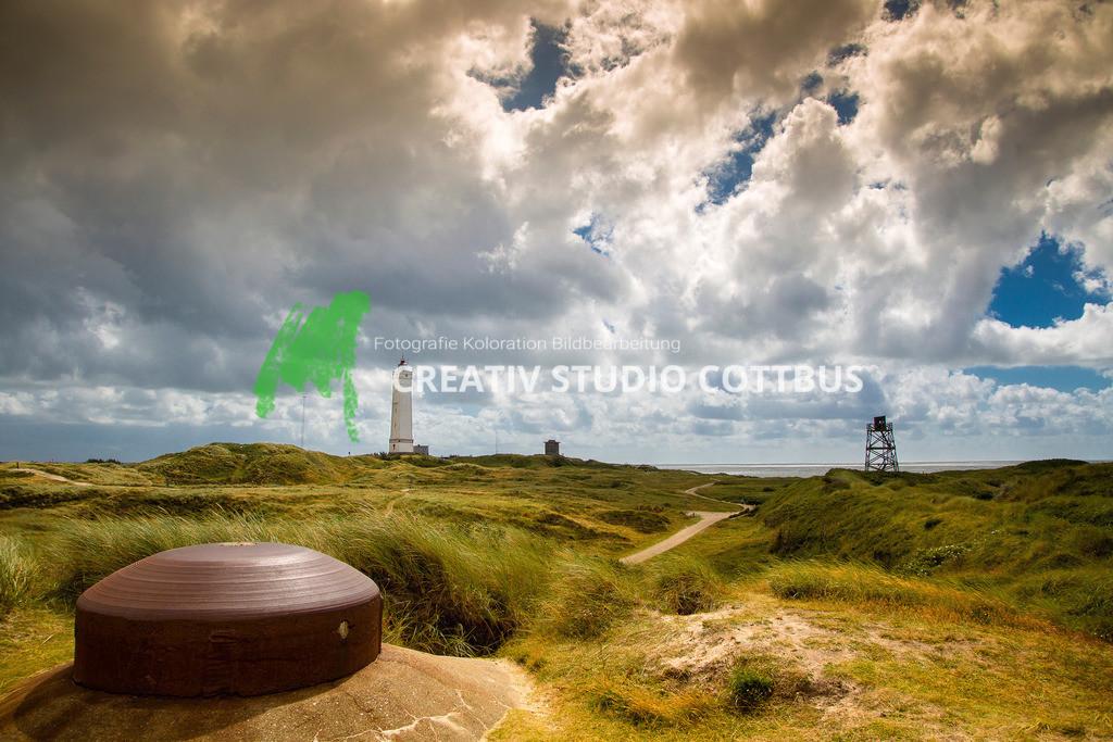 Dänemark und seine Geschichte | Dänemark- Strand mit Leuchtturm und Bunker