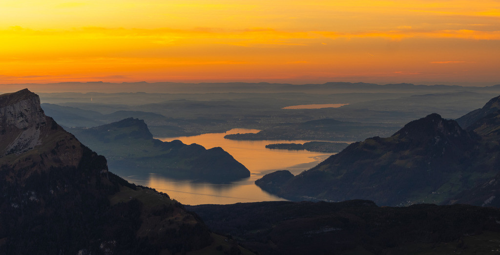 Lake Lucerne | An infinite lake with golden water in the setting sun.