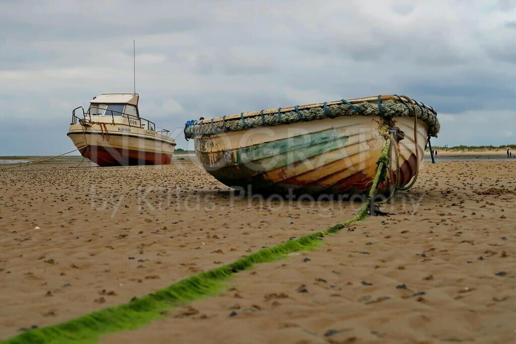 Boote am Strand | Boote am Strand auf der Wattseite der Nordseeinsel Texel.