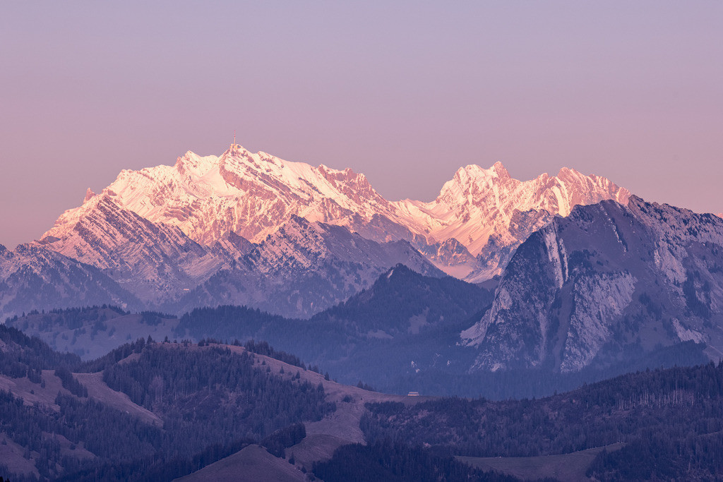 Twilight at Säntis | Shortly before sunset, the Säntis in Appenzell, Switzerland, is bathed in a pinkish red light.
