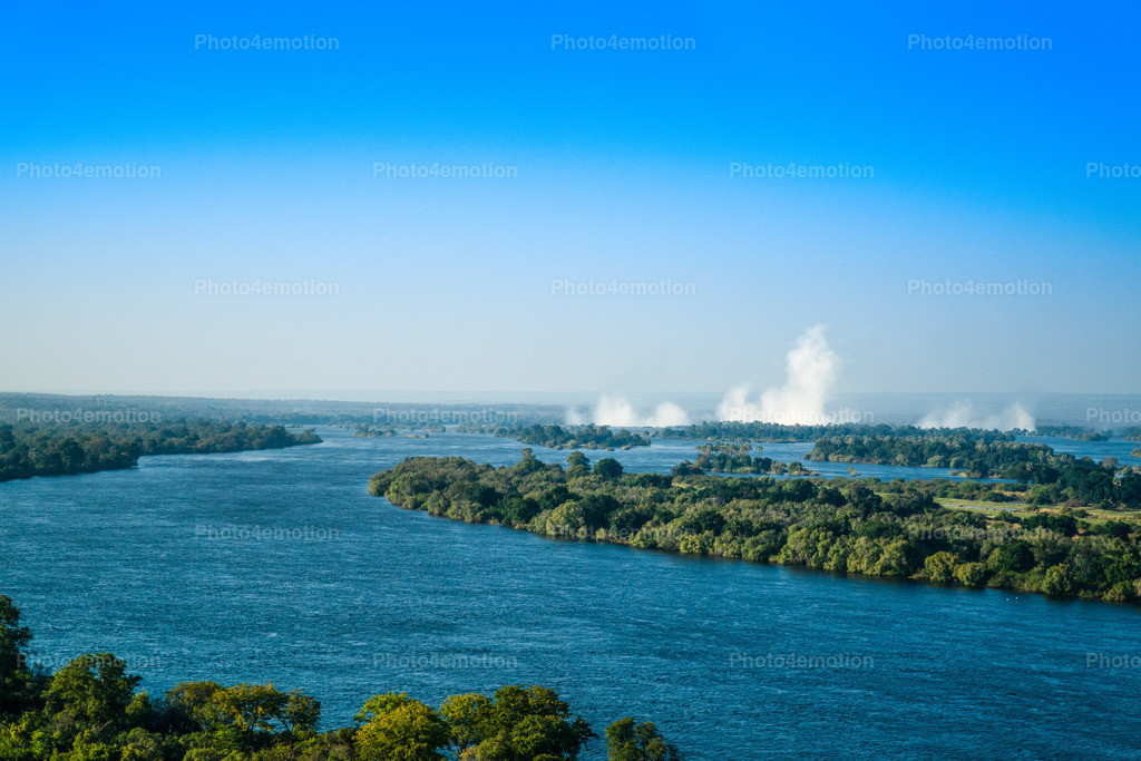 GRO09941   The Victoria Falls are a wide waterfall of the Zambezi River between the border towns of Victoria Falls in Zimbabwe and Livingstone in Zambia. Since 1989, the falls belong to the World Natural Heritage of UNESCO.
