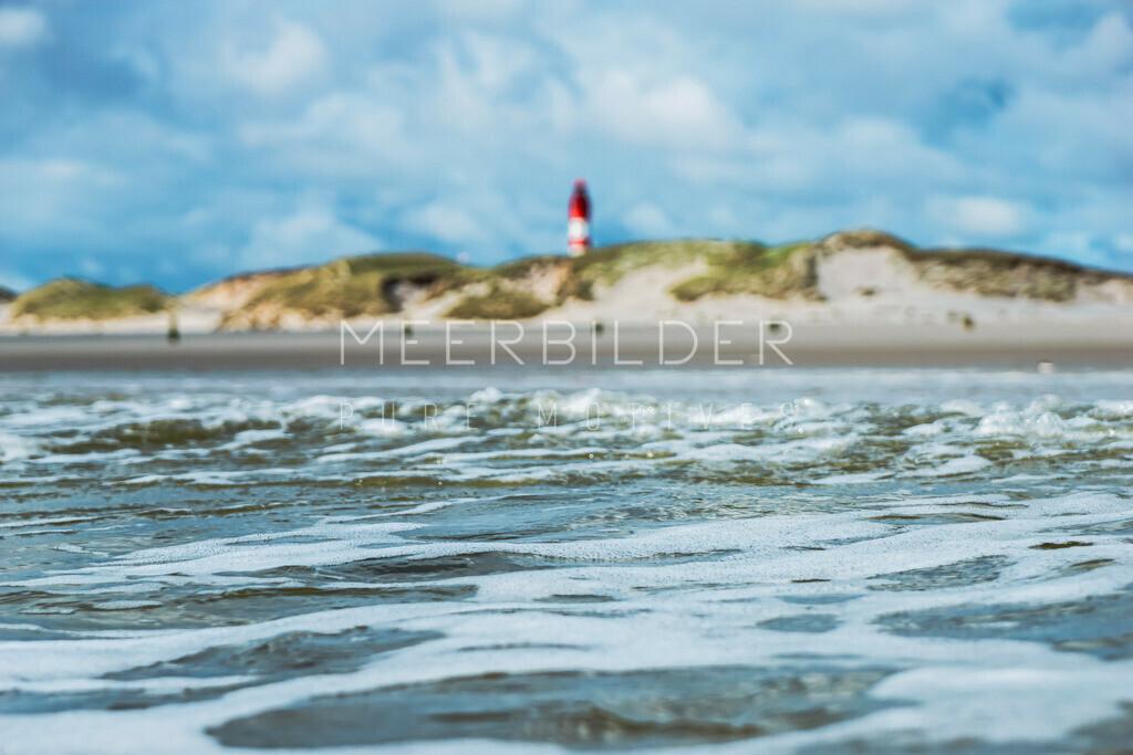 Nordsee Bilder VIII | Waterfront Strandbild Nordsee mit Leuchtturm im Hintergrund auf Alu Dibond, Fotoleinwand oder Acrylglas.