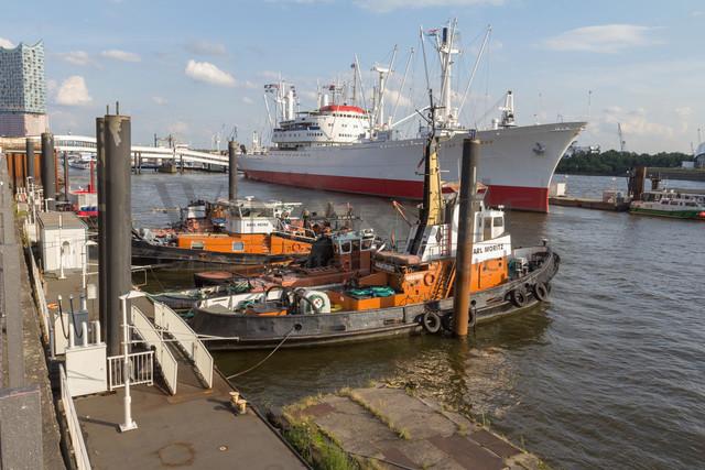 tugboats and a cargo ship | tugboats and a cargo ship in the port of hamburg