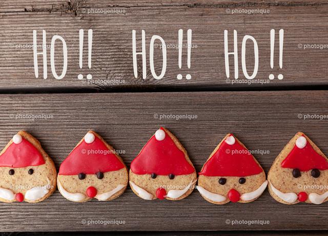 Weihnachtskarte fünf Weihnachtsmänner rufen Ho Ho Ho | Weihnachtskarte fünf Weihnachtsmänner rufen Ho Ho Ho bei Tageslicht