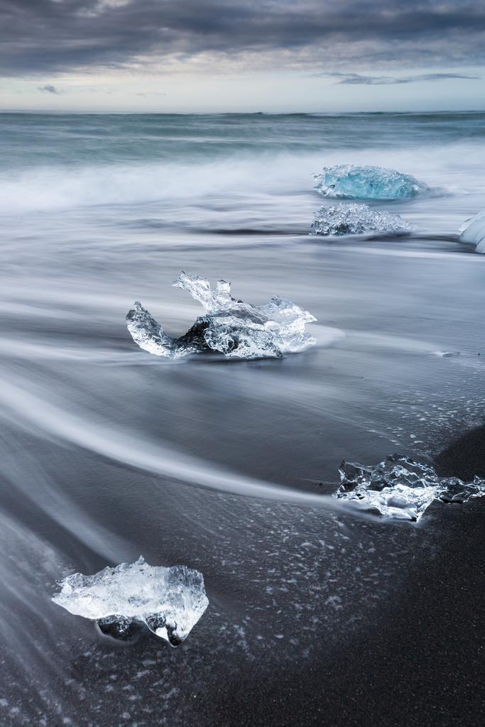 Diamonds | Like diamonds the icebergs are being washed ashore on the black beach of Jökulsarlon.