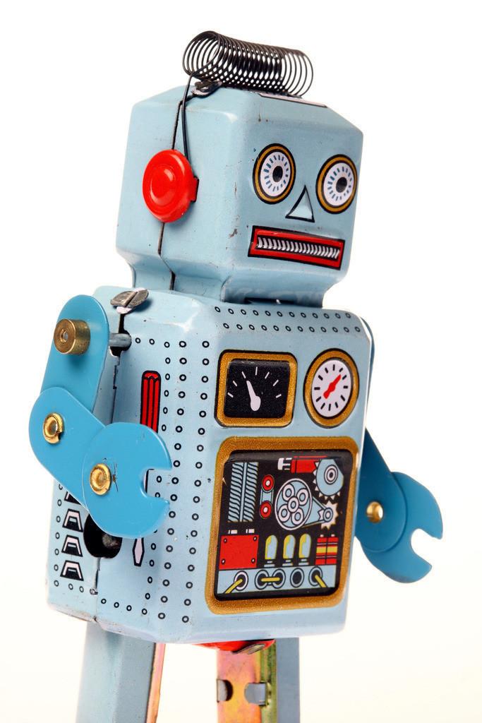 Roboter | Spielzeug Roboter, aus Metall, aufziehbar mit einem Schluessel, laeuft herum. Blechspielzeug.