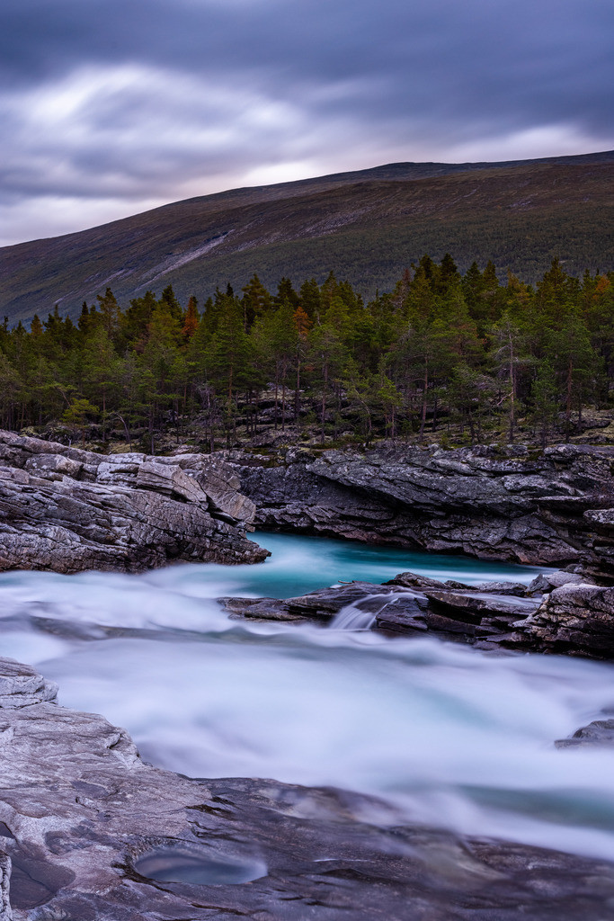 Mountain river in the evening | A little bit dark, but still fascinating because of the turquoise color of the river