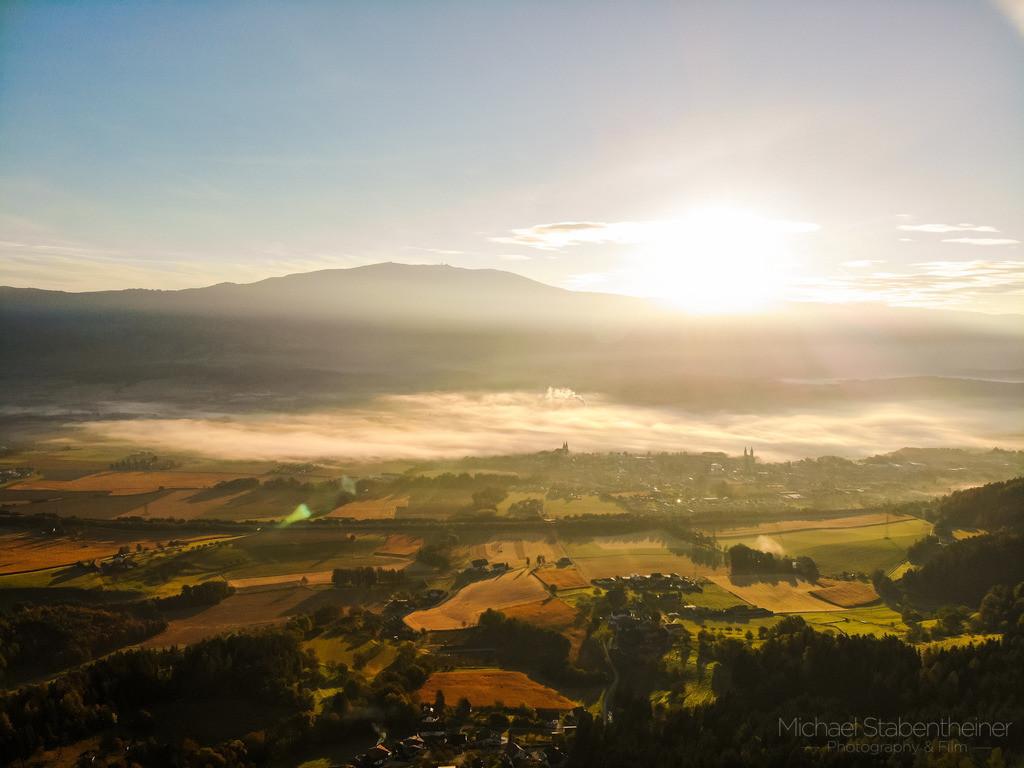Lavanttal | Luftbild vom Lavanttal mit Blick Richtung St. Andrä und der Koralpe im Sonnenaufgang