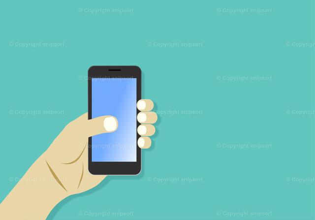 Männliche Hand mit einem Smartphone | Ein männliche Hand hält ein Smartphone über einem türkisen Hintergrund.