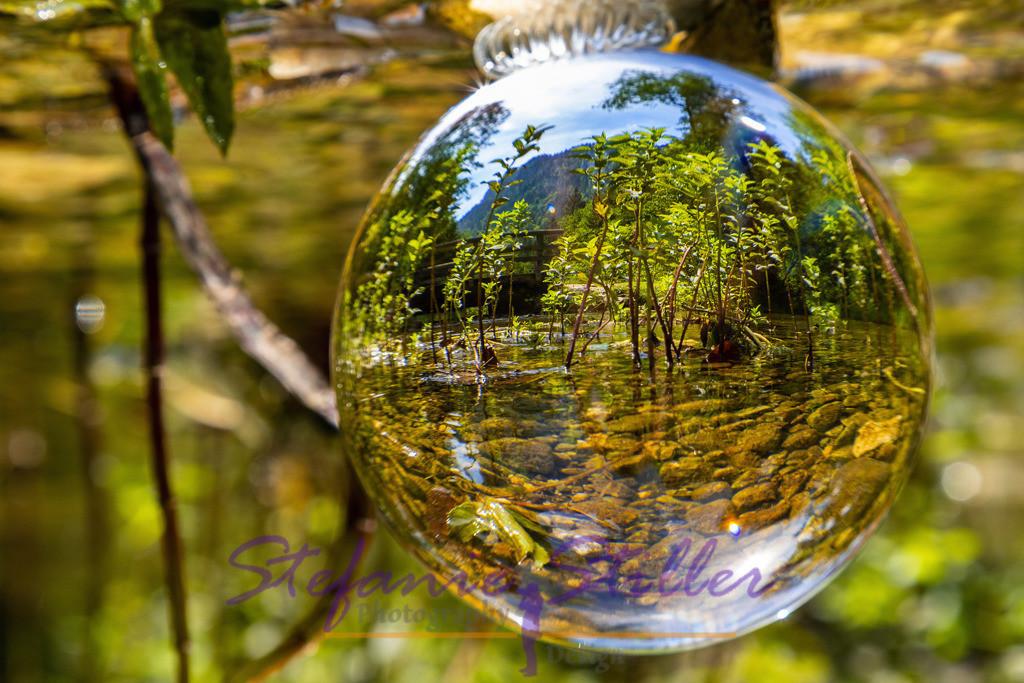 Falkenstein in a ball / Falkenstein in einem Ball | Falkenstein (Mountain) and Falkenseebach as reflection in a lensball / Der Berg Falkenstein und der Falkenseebach spiegeln sich in einem Lensball