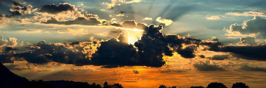 Wolken und Sonne | Dramatische Wolken am Sonnenuntergang