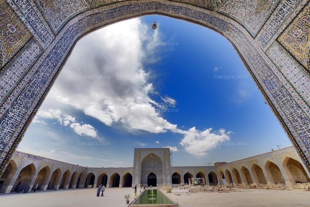 Vakil Mosque - Vakil-Moschee   Die Vakil-Moschee ist eine Moschee in Shiraz im südlichen Iran und befindet sich westlich des Vakil-Basars neben ihrem Eingang. Diese Moschee wurde zwischen 1751 und 1773 während der Zand-Zeit erbaut. Es wurde jedoch im 19. Jahrhundert während der Qajar-Zeit restauriert.  The Vakil Mosque (Persian: مسجد وکیل - Masjed-e Vakil) is a mosque in Shiraz, southern Iran, situated to the west of the Vakil Bazaar next to its entrance. This mosque was built between 1751 and 1773, during the Zand period; however, it was restored in the 19th century during the Qajar period. Vakil means regent, which was the title used by Karim Khan, the founder of Zand Dynasty. Shiraz was the seat of Karim Khan's government and he endowed many buildings, including this mosque