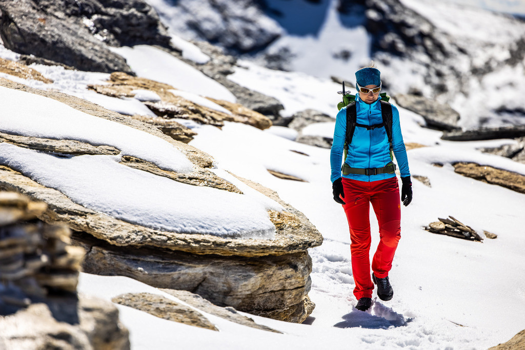 Female alpinist | A female alpinist the mountains with rocks and snow