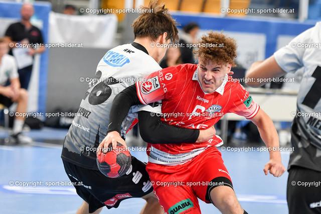 AUT, HLA, HC Linz AG vs Schwaz Handball Tirol   09.10.2021, Sporthauptschule Linz-Kleinmuenchen, AUT, HLA, HC Linz AG vs  Schwaz Handball Tirol, im Bild Sinisa Sironjic (Linz) vs Petar Medic (Tirol)
