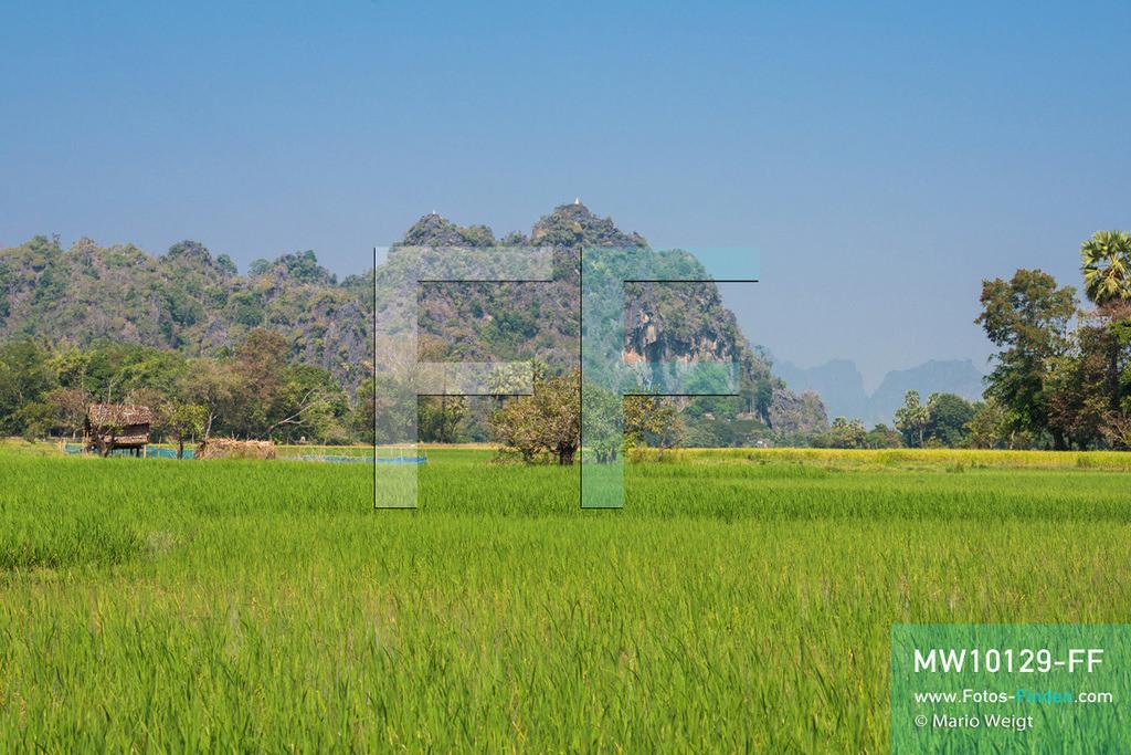 MW10129-FF   Myanmar   Hpa-an   Reportage: Zin mag Thanaka-Paste   Zin's Dorf ist von einer wunderschönen Landschaft umgeben. Die 7-jährige Nwe Zin Aye lebt im Dorf La Ka Nha nahe der Stadt Hpa-an. Sie bemalt gern ihr Gesicht mit Thanaka-Paste. Nach der burmesischen Tradtition tragen fast alle Mädchen und Frauen diese Art von Schminke.   ** Feindaten bitte anfragen bei Mario Weigt Photography, info@asia-stories.com