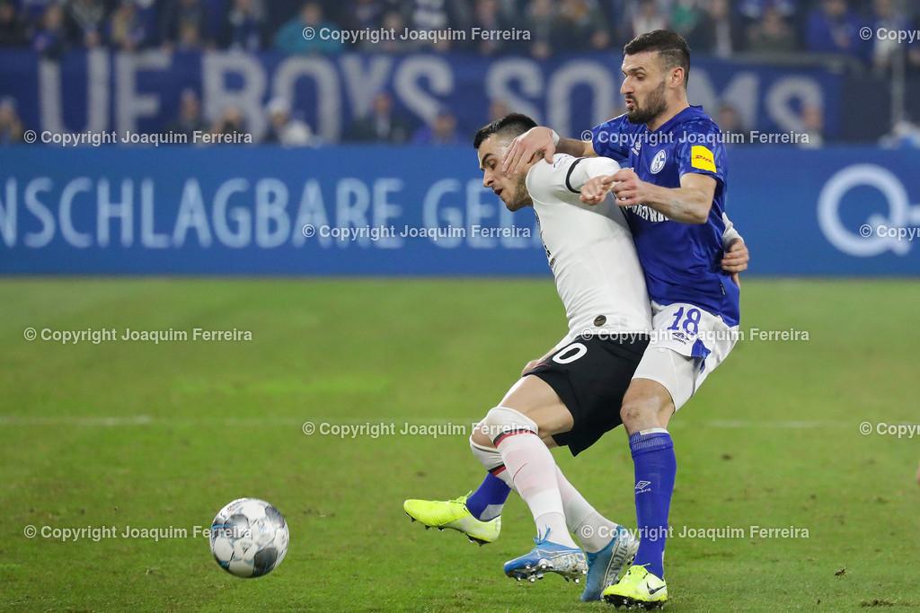 191215_schvssge_0064 | 15.12.2019 Fussball 1.Bundesliga, FC Schalke 04 - Eintracht Frankfurt  emspor  v.l.,  Filip Kostic  (Eintracht Frankfurt), Daniel Caligiuri (FC Schalke 04),Zweikampf, Action, Aktion, Battles for the Ball    (DFL/DFB REGULATIONS PROHIBIT ANY USE OF PHOTOGRAPHS as IMAGE SEQUENCES and/or QUASI-VIDEO)