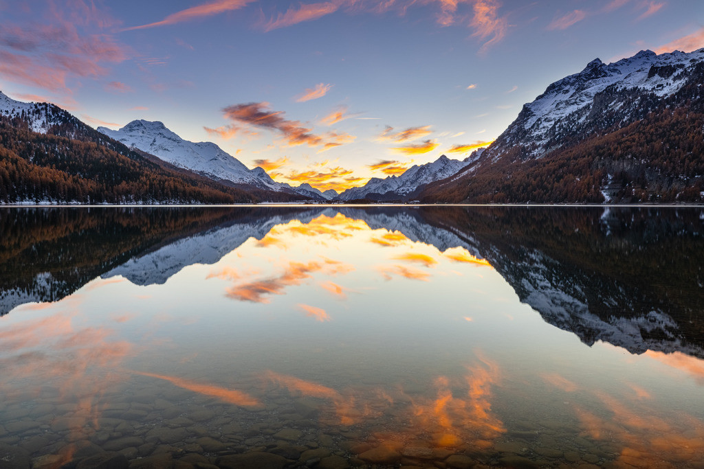 The burning lake | A gorgeous combination of sunset in the evening, crystal-clear water in the mountain lake and some small clouds on the sky.