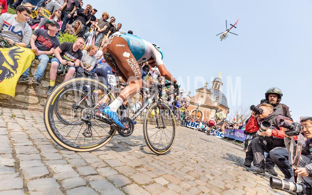 Team AG2R La Mondiale rider Julien Duval (FRA) racing at the Ronde van Vlaanderen UCI men elite road racing event, Muur van Geraardsbergen, Belgium | Muur van Geraardsbergen, Belgium - April 7, 2019: Team AG2R La Mondiale rider Julien Duval (FRA) racing at the Ronde van Vlaanderen UCI men elite road racing event