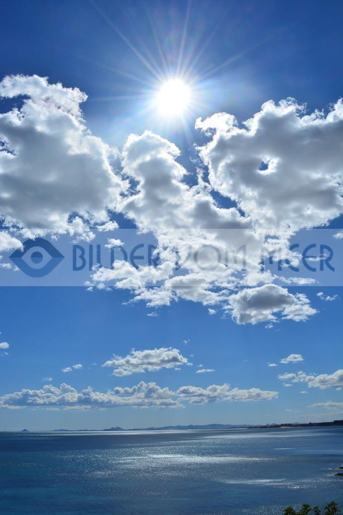 Bilder vom Meer | Sonne und Wolken über dem Meer