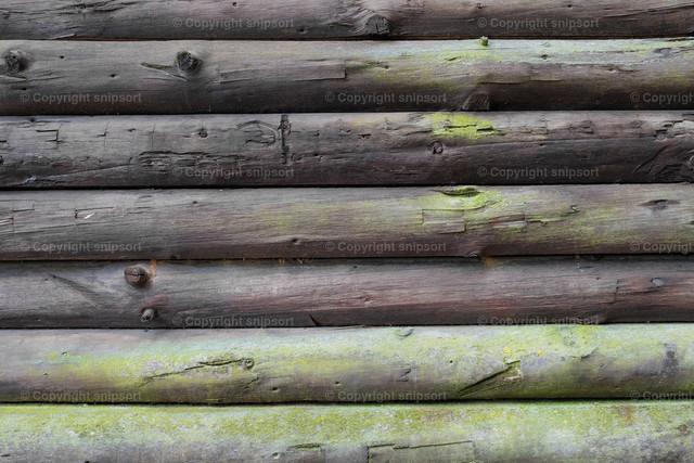 Fassade eines Holzblockbaus | Wand als Hintergrundbild einer Holzblockfassade.