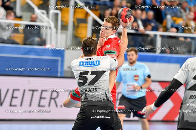 AUT, HLA, HC Linz AG vs Schwaz Handball Tirol   09.10.2021, Sporthauptschule Linz-Kleinmuenchen, AUT, HLA, HC Linz AG vs  Schwaz Handball Tirol, im Bild Lucijan Fizuleto (Linz) vs Balthasar Huber (Tirol)