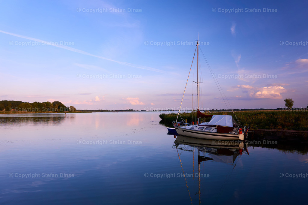 peaceful evening with boat on lake | peaceful evening with boat on lake