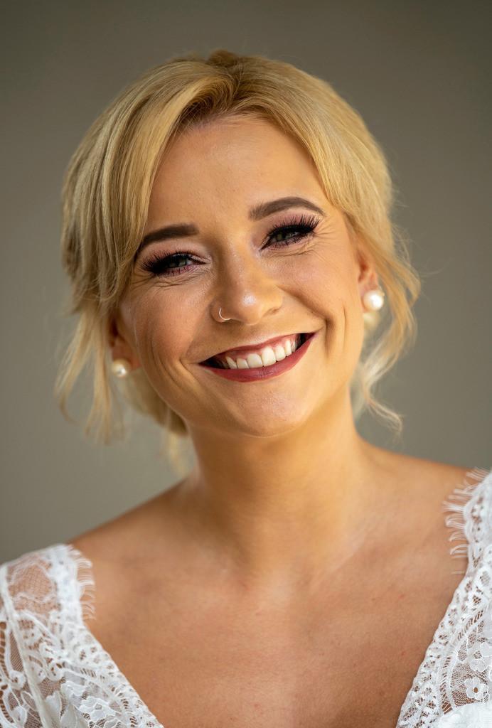 54C397A0-BC50-40C2-98E8-BF4F4250B9BA | Smiling bride before her wedding