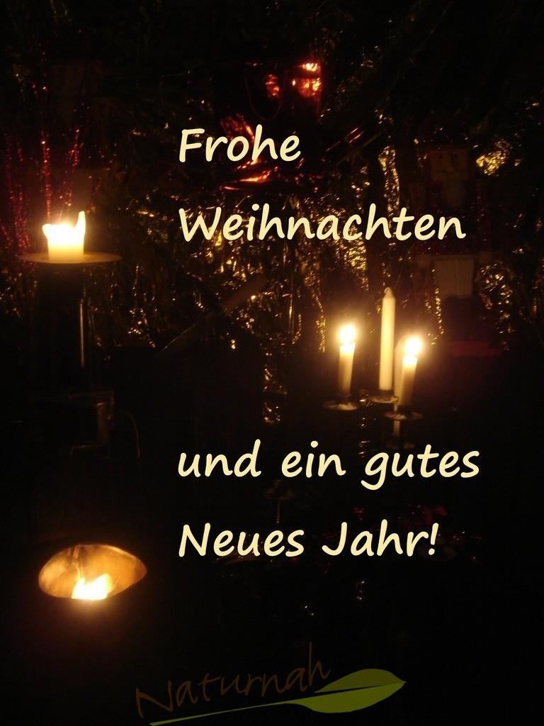 Weihnachtsgrüße mit Kerzen