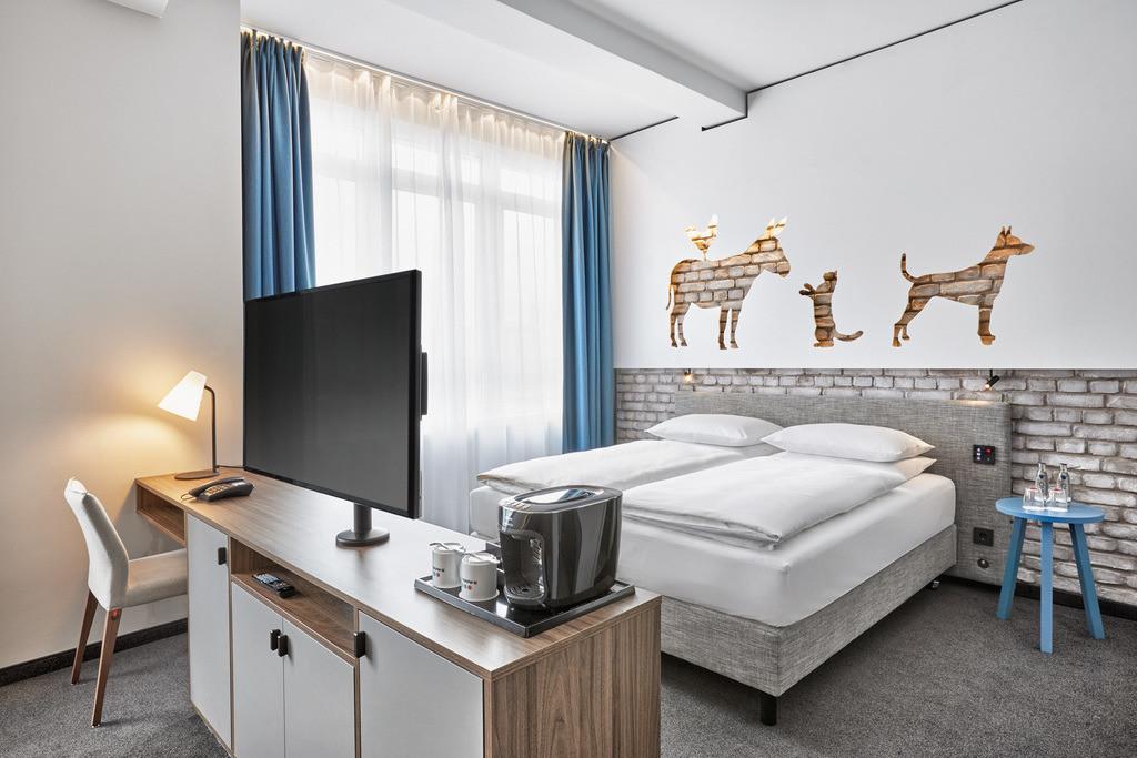 zimmer-deluxe-kingzimmer-04-hplus-hotel-bremen.tif