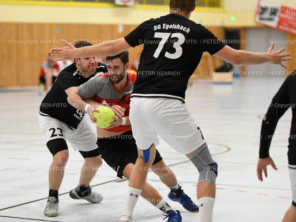 Handball Männer Landesliga MSG Rossdorf Reinheim - SG Egelsbach copyright HEN-FOTO | 16.2.2020 Handball Männer Landesliga MSG Rossdorf Reinheim - SG Egelsbach (25:26) li 23 Lukas Gärtner (E) Mi 62 Lars Schmidt (Ro) copyright + Foto: Peter Henrich (HEN-FOTO)