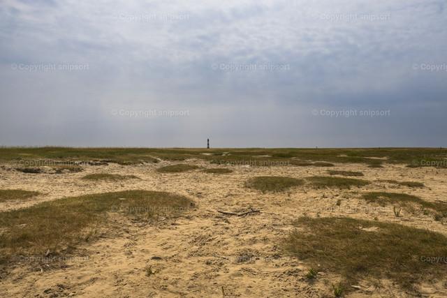 Leuchtturm vom Wattenmeer aus | Nordische Impressionen vom Wattenmeer mit Blick auf einen Leuchtturm.