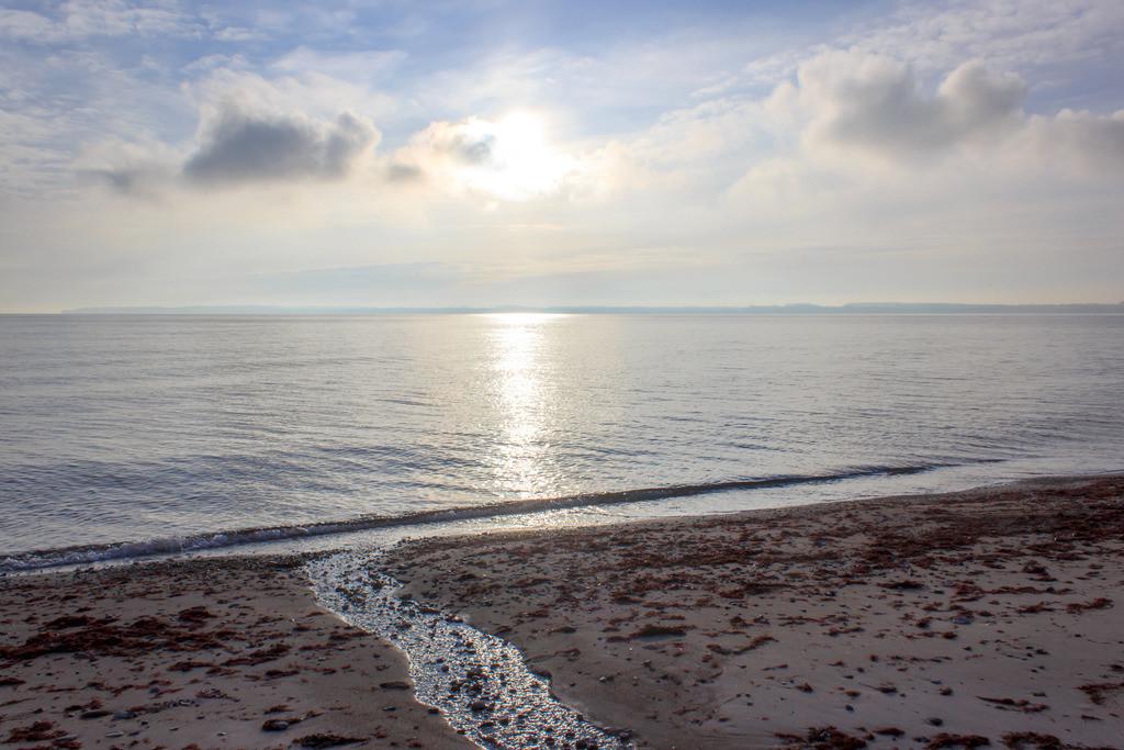 Strand in Langholz   Sonne über der Ostsee in Langholz