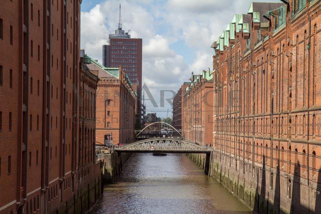 hamburg canal with a bridge | Speicherstadt hamburg canal with a bridge landscape