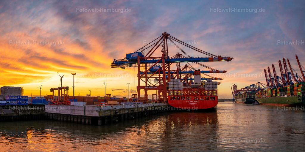 10201018 - Leuchtender Himmel in Waltershof | Spektakulärer Sonnenuntergang im Waltershofer Hafen mit Blick auf das Containerschiff Cap San Marco.