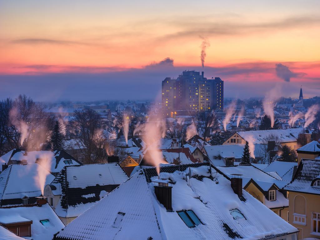 Früh morgens über den Dächern von Bielefeld | Sonnenaufgang an einem Wintermorgen über Bielefeld.